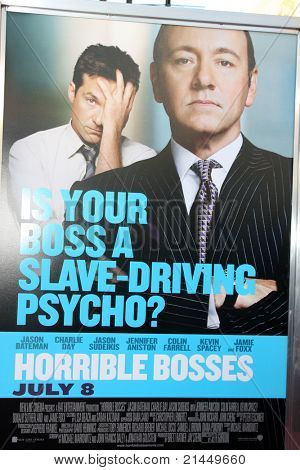 LOS ANGELES - JUN 30:  Horrible Bosses Movie Poster with Jason Bateman & Kevin Spacey arriving at the