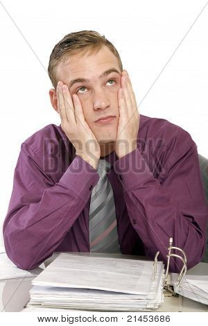 Exhausted Man In Office With Documents
