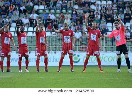 KAPOSVAR, HUNGARY - MAY 14: Szolnok players before a Hungarian National Championship soccer game - Kaposvar vs Szolnok on May 14, 2011 in Kaposvar, Hungary.