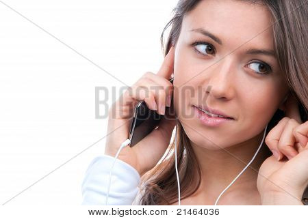 Close-up Portrait Of Young Girl Listening And Talking On Mobile Phone
