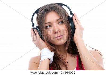 Cheerful Brunette Woman Listening And Enjoying Music In Big Headphones