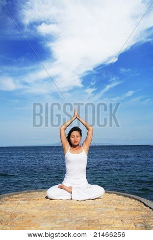 Cute Asian Woman Meditating