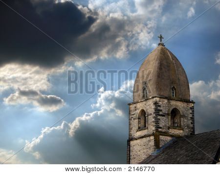 Stone Steeple And Stormy Sky