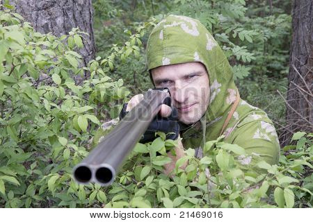 The Shooter In Camouflage