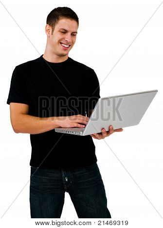 Smiling Man Using A Laptop