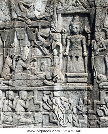 Scene from the bas-relief of Bayon Temple in the Angkor Area near Siem Reap, Cambodia.