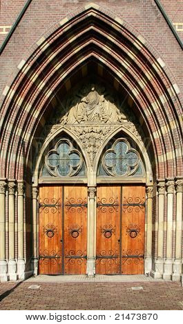 Set of wooden church doors with iron hinges and stained glass  (Amsterdam, Holland)