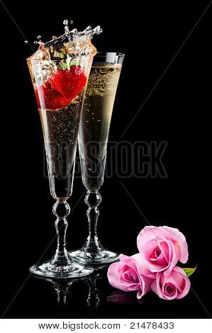 Two Glasses Of Sparkling Wine (champagne) With Pink Roses