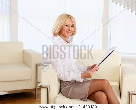 young business woman with papers