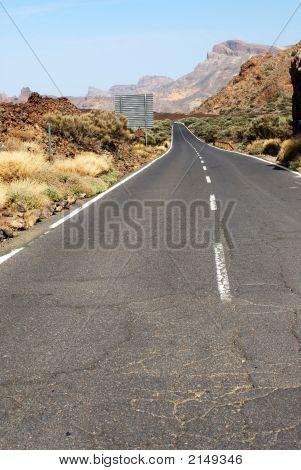 Asphalt Road Through Stony Tenerife Desert