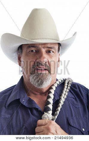Old cowboy with a bullwhip