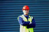 foto of hard_hat  - construction worker with folded arms - JPG