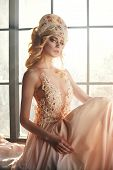 Fairy With Long Blonde Hair In Light Is On Background Of A Large Window, Art Fashion Girl. Beautiful poster