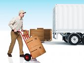 stock photo of delivery-truck  - young delivery man with red handtruck - JPG