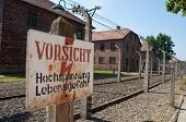 foto of auschwitz  - electric wired fence warning sign in concentration camp Auschwitz in city Oswiencim Poland - JPG