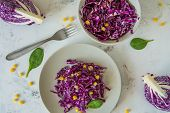 Fresh red cabbage salad with corn. Vegeterian and diet food top view.