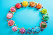 Tasty cupcakes on color background poster