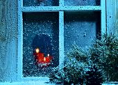 Frosted Window With Burning Candles.christmas Greeting Card.athmosperic Photography.closeup. Selecti poster