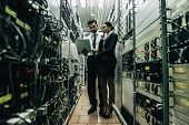 Man And Woman In Data Centre poster