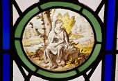 stock photo of stained glass  - A Victorian stained glass window depicting Saint Jerome in the wilderness - JPG