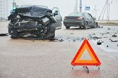 Accident or crash with two automobile. Road warning triangle sign in focus poster