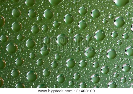 Water Drops On Green Glass Surface