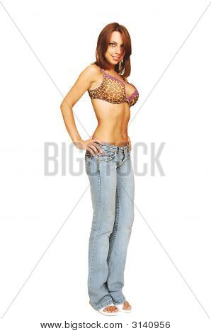 Standing Woman In Jeans And Bra.