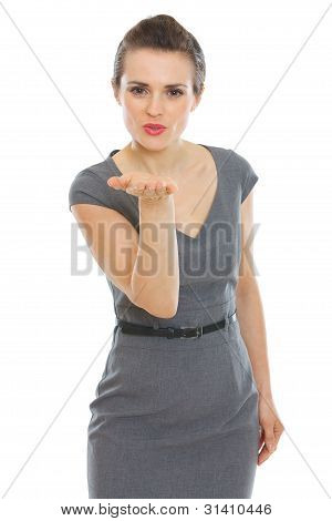 Elegant Woman In Dress Blowing Air Kiss