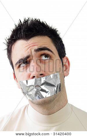 Young Man Having Gray Duct Tape On His Mouth