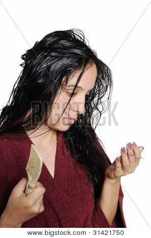 Girl Sad Because Of Hairfall Problem. She Is Holding Hair Strands In Her Hand.