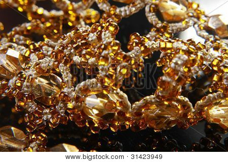 Yellow Amber Jewelry On A Black Background