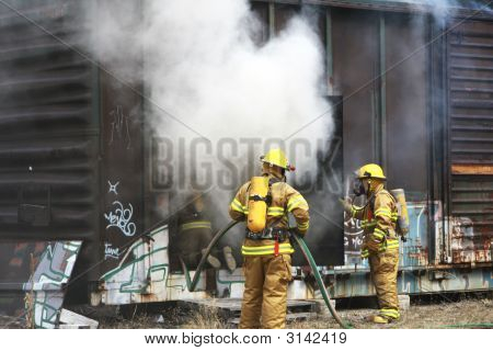 Firemen Working To Put Out Fire