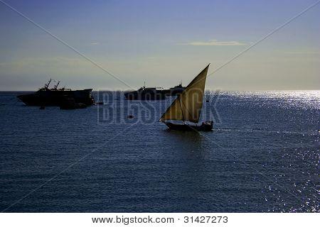 Fisherman's Boat And Ships In The Port Of Stone Town, Zanzibar, Tanzania