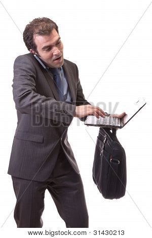 executive struggling with laptop in hand