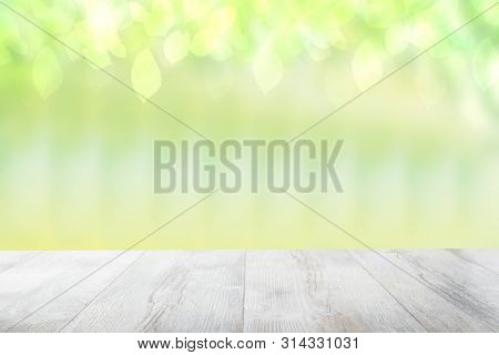 poster of Empty Table Top Summer Background. Empty Rustic Wooden Bright Table Top In Front Of A Beautiful Abst