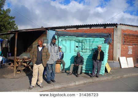 group of man wait on the side of a street