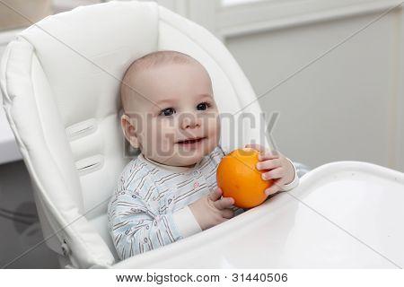 Happy Baby Holding Orange