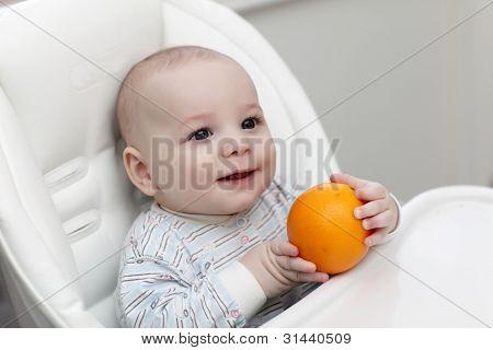 Happy Baby With Orange