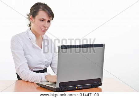 Girl Works On Laptop