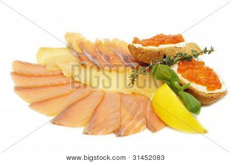 a plate of fish and caviar