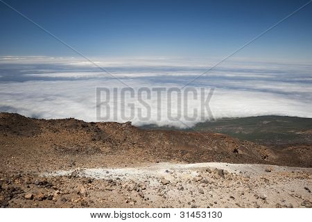 Rocky mountains above the clouds