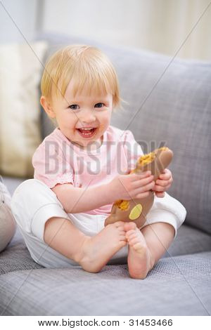Happy Baby Eating Easter Rabbit Cookie