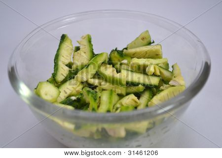 Diced Bitter Melon In Bowl On White Background
