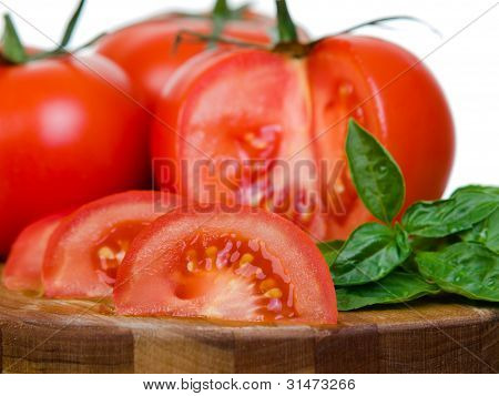 Tomatoes Presentation Sliced On Wooden Plank Macro