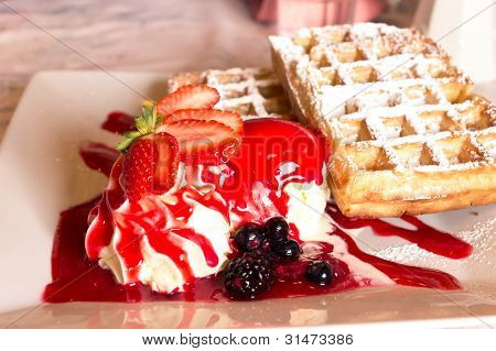 Belgian waffle with strawberry ice cream