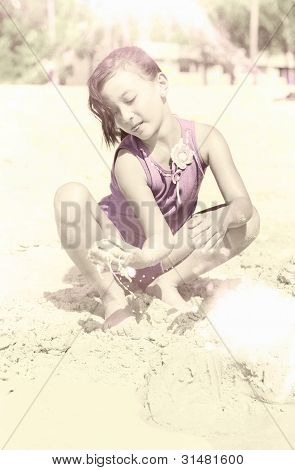 Retro Girl Playing In Beach Sand