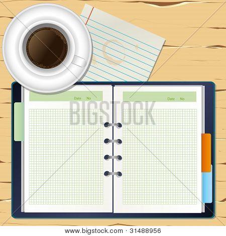 een kopje koffie en een laptop op het Bureau