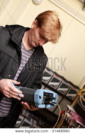 Technician Looking At Reflectometer