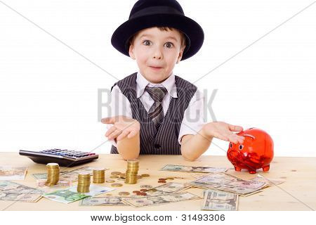 Sly boy at the table with money
