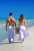 Couple Walking At Beach